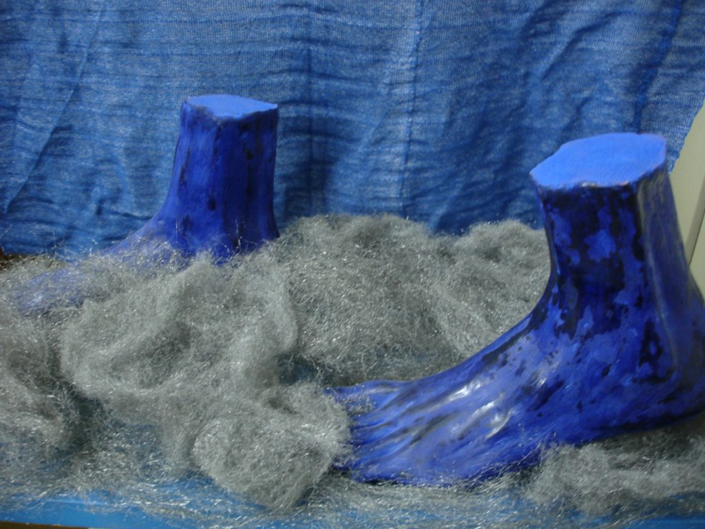 blue feet with clay and pigments.